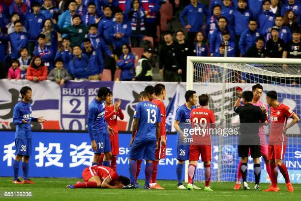 This photo taken on March 11 2017 shows Shanghai Shenhua's Qin Sheng receiving a red card during the Chinese Super League match against Tianjin...
