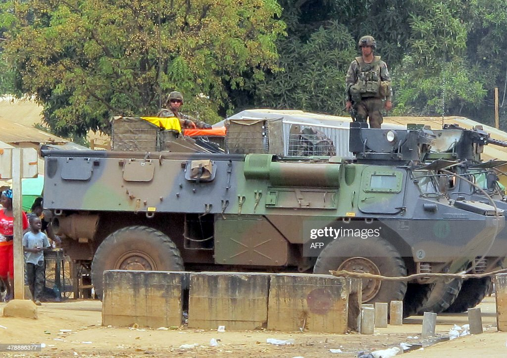 This photo taken on March 13, 2014 shows French soldiers standing atop a French armored vehicle part of the Sangaris operations, parked on the Centrafrican side of the frontier post of Garoua-Boulai, eastern Cameroon, strategically located on the axis linking Bangui to Cameroon. Trade traffic resumed mid-March 2014 between Cameroon and the Central African Republic, with convoys escorted by the French army, although the Cameroonian drivers still fear the violence tearing entire regions on the road to Bangui.