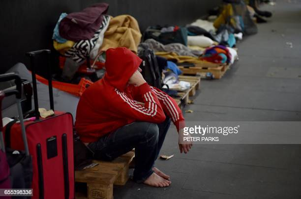 This photo taken on March 13 2017 shows a resident in a makeshift shelter for the homeless in Sydney which offers 24/7 access to free food and...