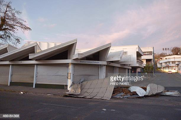 This photo taken on March 16 2015 shows debris of a corrugated iron roof in front of the French Cultural Center of PortVila in cycloneravaged Vanuatu...