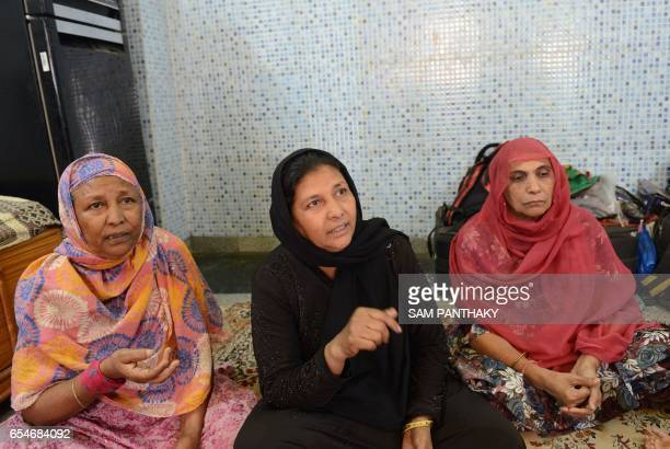 This photo taken on March 17 2017 shows Wahidaben Nasirkhan Pathan with other relatives in Ahmedabad speaking to the media about her sister...