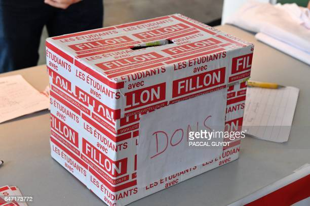 This photo taken on March 2 2017 shows a donation box by students for Les Republicans political party candidate for the 2017 presidential election...