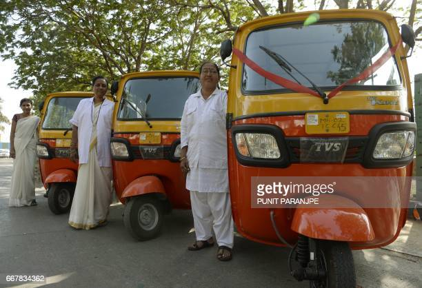 This photo taken on March 20 2017 shows female Indian rickshaw drivers posing for a picture ahead of their vehicle registration process in Mumbai...