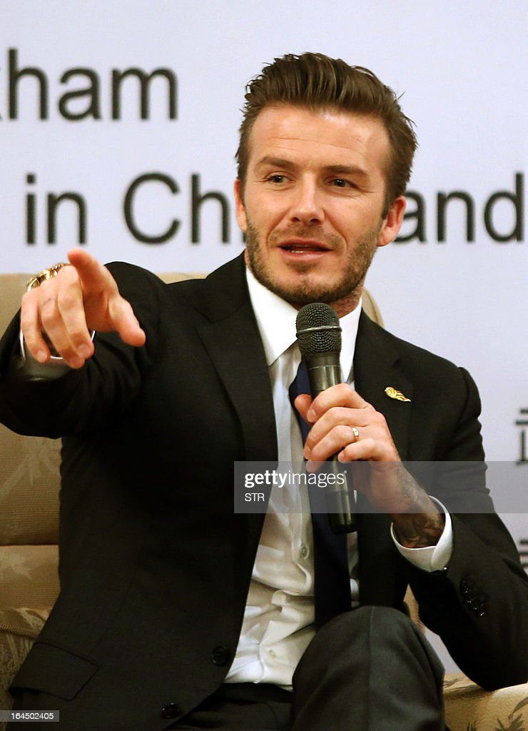 This photo taken on March 23, 2013 shows English football superstar David Beckham speaking at a promotional event at the Zall Football Club in Wuhan, in central China's Wuhan province. Beckham raised the prospect of one last stop on his global football journey on March 20, refusing to rule out playing in China after his contract with Paris Saint-Germain ends. CHINA