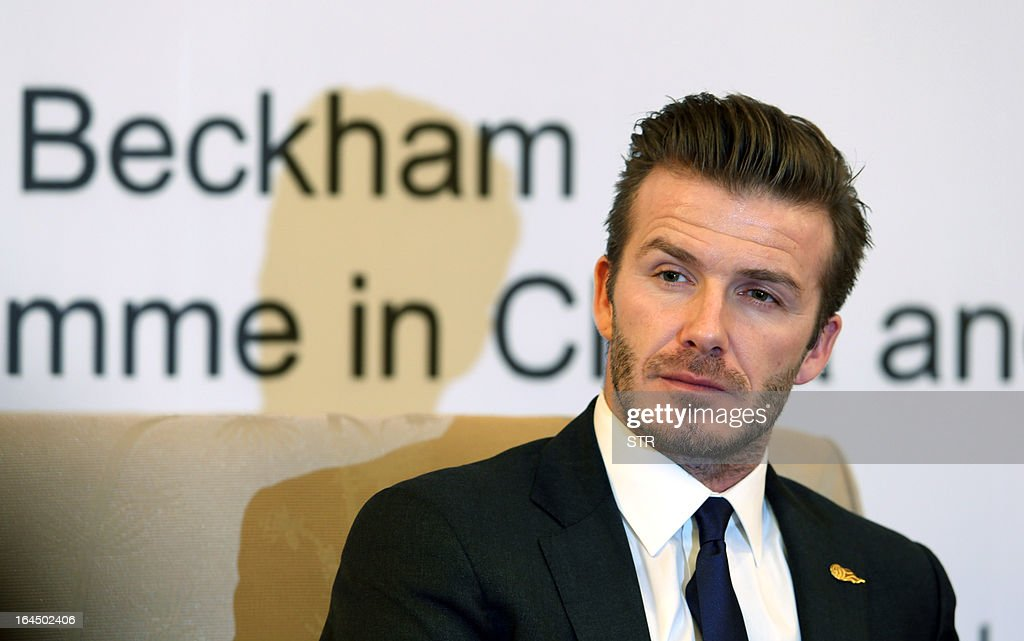 This photo taken on March 23, 2013 shows English football superstar David Beckham attending a promotional event at the Zall Football Club in Wuhan, in central China's Wuhan province. Beckham raised the prospect of one last stop on his global football journey on March 20, refusing to rule out playing in China after his contract with Paris Saint-Germain ends. CHINA OUT AFP PHOTO