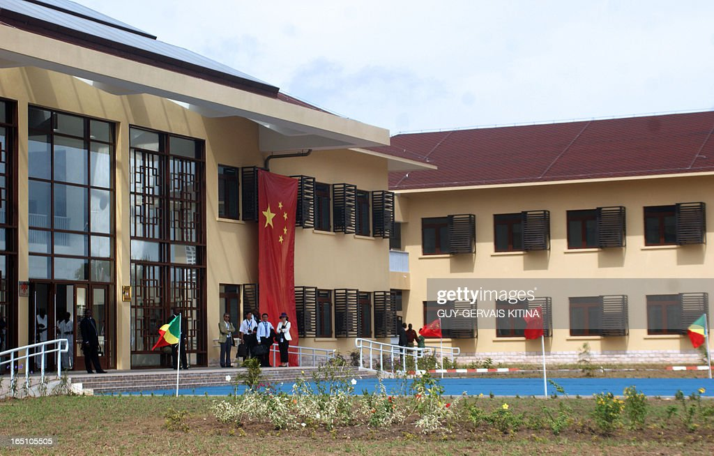 This photo taken on March 30, 2013 in Mfilou, a neighborhood west of Brazzaville, shows the main facade of the Chinese-built hospital which new Chinese president Xi Jinping inaugurated today. Xi ended his first foreign trip today with the first-ever visit by a Chinese president to the Congo, a small and impoverished country in central Africa, which has significant oil resources and other untapped mineral wealth. On his second and last day in Brazzaville Xi and Congo's President Denis Sassou Nguesso met members of the Chinese community and attended the inauguration of a Chinese-built hospital and the capital's largest university library before his plane took off for Beijing. AFP PHOTO/ Guy-Gervais Kitina