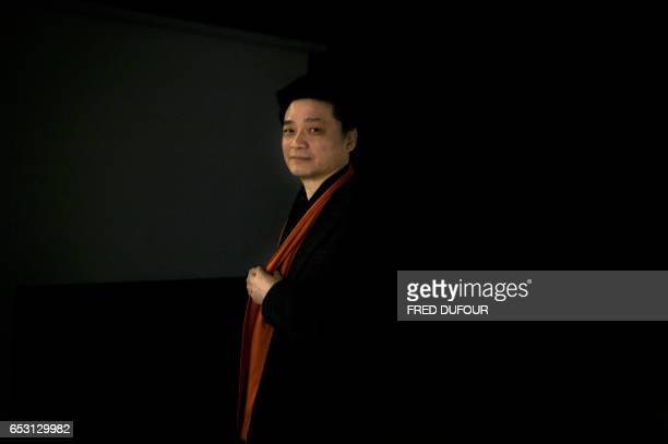 This photo taken on March 7 2017 shows Chinese television host and producer Cui Yongyuan posing in Beijing Empty talk selfcensorship braindead...