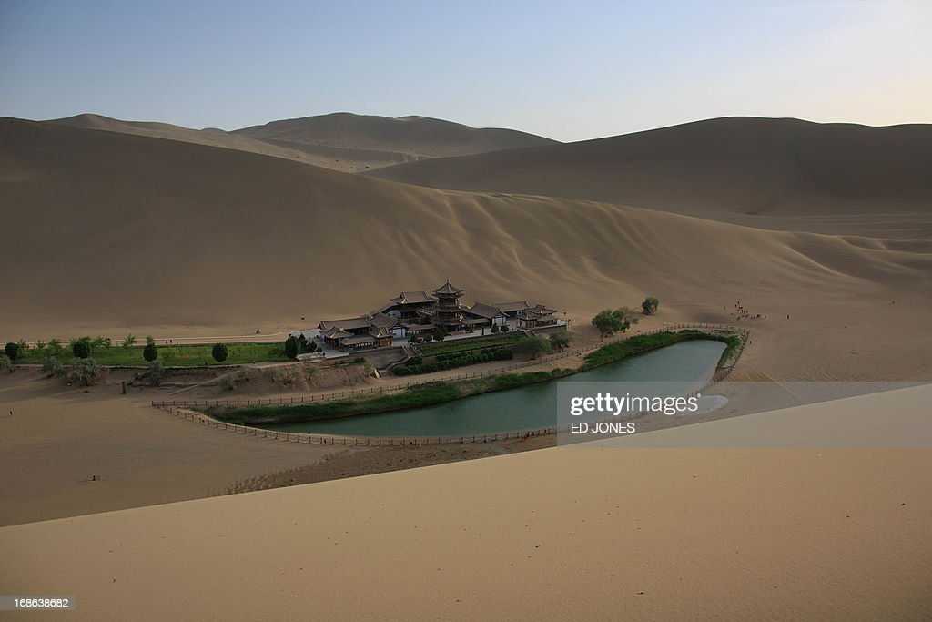 This photo taken on May 12, 2013 shows a general view of the Yueyaquan Crescent Lake in Dunhuang in China's northwestern Gansu province. Formerly a silk route hub and centre for trade between China and the West, Dunhuang relies heavily on tourism and features a number of historic sites dating back to the Han Dynasty. The city has an arid climate and is surrounded by sand dunes, a result of increasing desertification. AFP PHOTO / Ed Jones