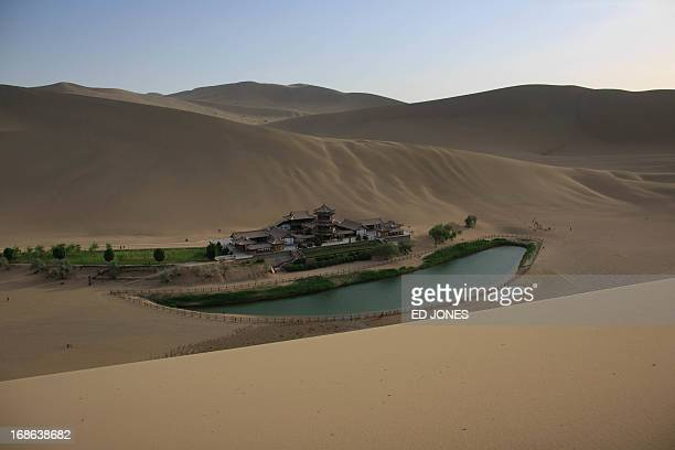 This photo taken on May 12 2013 shows a general view of the Yueyaquan Crescent Lake in Dunhuang in China's northwestern Gansu province Formerly a...