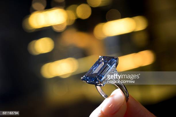 This photo taken on May 12 2016 in Geneva during a press preview by Christies's auction house shows the 'Oppenheimer Blue' a rare fancy vivid blue...
