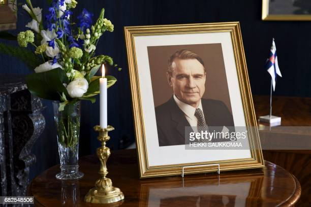 This photo taken on May 13 2017 in the presidential castle in Helsinki shows a portrait of former Finnish President Mauno Koivisto who passed away in...