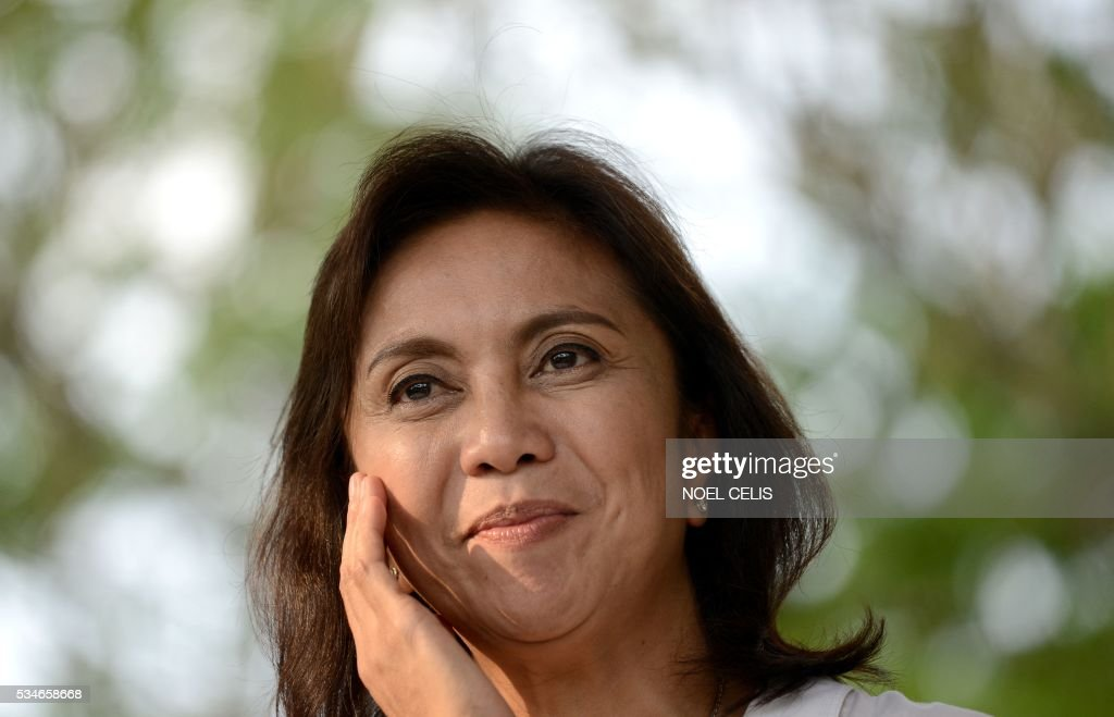 This photo taken on May 15, 2016 shows vice-presidential candidate and activist lawyer-turned congresswoman Leni Robredo in front of her supporters after attending a mass at the Church of Gesu at the Ateneo de Manila University in Manila. The son and namesake of the late Philippine dictator Ferdinand Marcos has narrowly lost the election for vice president to political neophyte Leni Robredo, according to an official count that was only completed on May 27, almost three weeks after polls closed. / AFP / NOEL
