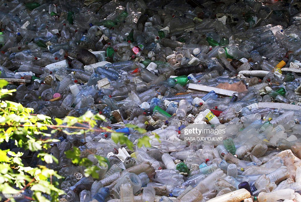 This photo taken on May 15, 2013, shows a view of the South Morava river filled with discarded plastic bottles and other garbage, near the town of Vranje. AFP PHOTO / SASA DJORDJEVIC