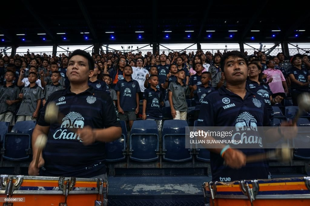 This photo taken on May 17, 2017 shows Buriram United football fans watching a Thai Premier League match at the i-Mobile 'Thunder Castle' stadium in the northeastern Thai province of Buriram. A 'godfather' of Thai politics is using cash and contacts to transform his once poor, forgotten rice-farming fiefdom into an unlikely sporting Camelot, complete with a football stadium and racetrack set to host the MotoGP. / AFP PHOTO / Lillian SUWANRUMPHA / TO GO WITH Thailand-politics-economy-sport, FEATURE by Sally Mairs