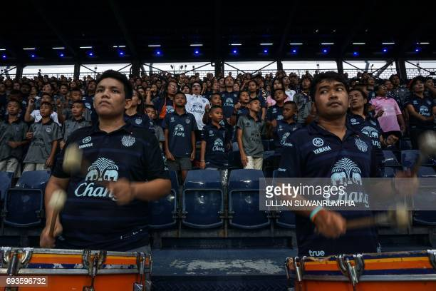 This photo taken on May 17 2017 shows Buriram United football fans watching a Thai Premier League match at the iMobile 'Thunder Castle' stadium in...