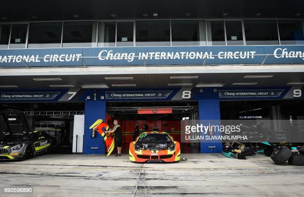 This photo taken on May 17 2017 shows cars being prepared for the 2017 Blancpain GT series at Chang International Circuit Thailand's first FIA Grade...
