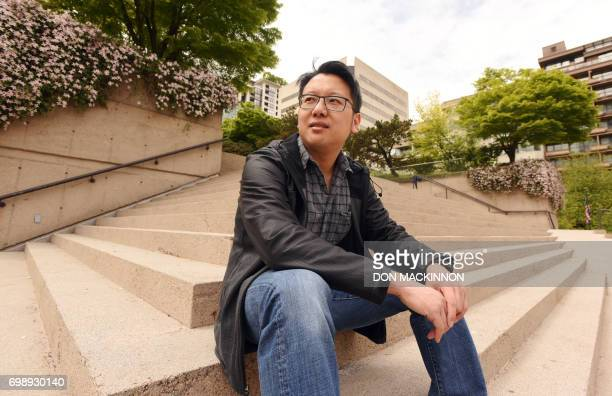 This photo taken on May 18 2017 shows Justin Fung posing in downtown Vancouver British Columbia Fung was born and raised in Vancouver after his...