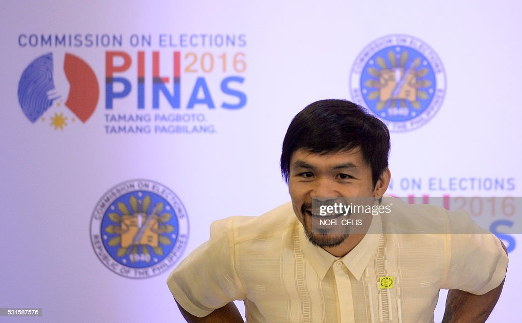 This photo taken on May 19, 2016, shows Philippine boxing icon and newly elected Senator Manny Pacquiao giving a statement suring a press conference at the Commission on Elections (COMELEC) proclamation of senators at the Philippine International Convention Center (PICC) in Manila. Boxing legend Manny Pacquiao is giving the Rio Olympics a miss as he tries to make good on his promise to be a full-time politician. Pacquiao, a newly proclaimed senator in the Philippines, said Friday that he was declining an invitation to compete in the Olympics in August to focus on being a top lawmaker. / AFP / NOEL