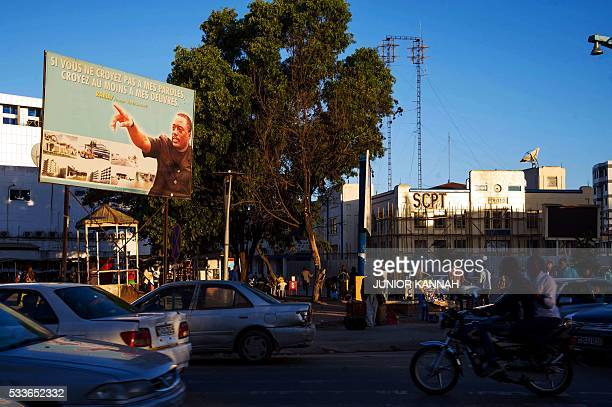 This photo taken on May 22 2016 in Lubumbashi shows a billboard featuring Democratic of Republic of Congo's President Joseph Kabila reading 'If you...