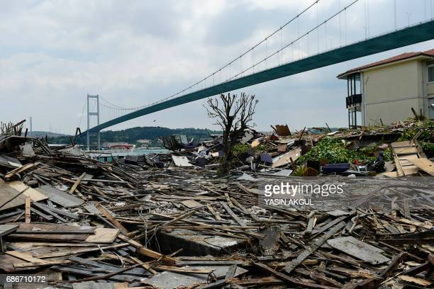 This photo taken on May 22 2017 near Bosphorus bridge in Istanbul shows the remaining debris from the demolition of the Reina nightclub Istanbul...