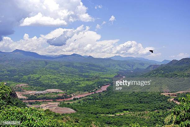 This photo taken on May 22 shows a faraway view of the controversial Gibe III dam under construction in Ethiopia's Omo valley and surrounding hills...