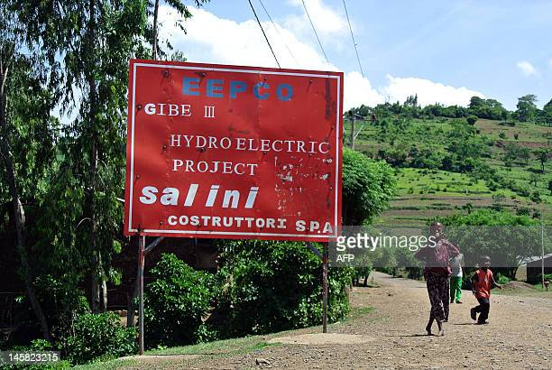 This photo taken on May 22 shows children playing near a signpost at an entrance to the controversial Gibe III dam under construction in Ethiopia's...