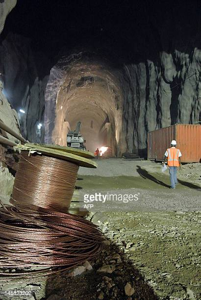 This photo taken on May 22 shows workers in an underground passage at the controversial Gibe III dam under construction in Ethiopia's Omo valley The...