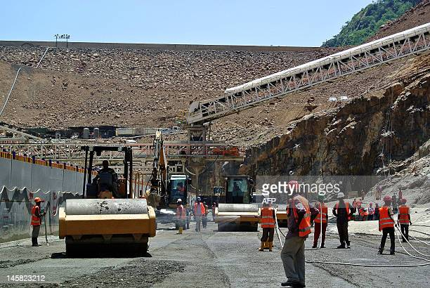 This photo taken on May 22 shows workers near the entrance of an underground tunnel at the controversial Gibe III dam under construction in...