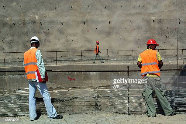 This photo taken on May 22 shows workers near the top of a chute at the controversial Gibe III dam under construction in Ethiopia's Omo valley The...