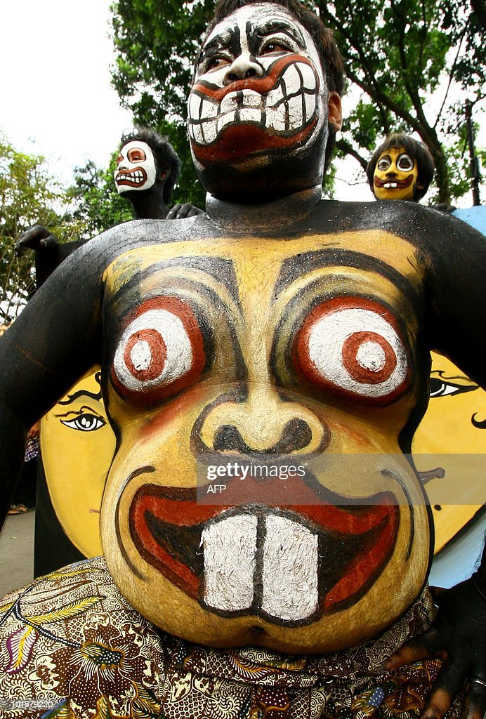 This photo taken on May 23, 2010 shows Indonesian performers parading with their bodies and faces are painted as masks during the traditional Topeng - or mask festival - in Malang, East Java province. Held in many parts of Indonesia, the highly popular masks festivities vary from modern colorful cutouts, papier-mache, and painted faces to the traditional woodcarvings symbolizing faces of spiritual figures that is largely part of ancient Javanese rituals.