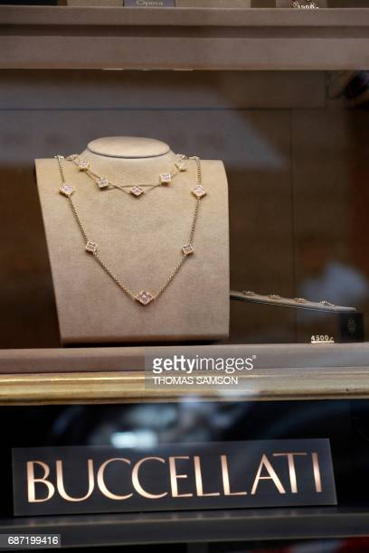 This photo taken on May 23 2017 in Paris shows jewelry within the window display of the Italian jewelry company Buccellati's Paris store as police...