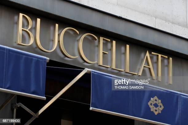 This photo taken on May 23 2017 in Paris shows the sign for the Italian jewelry company Buccellati's Paris store as police investigate a robbery A...