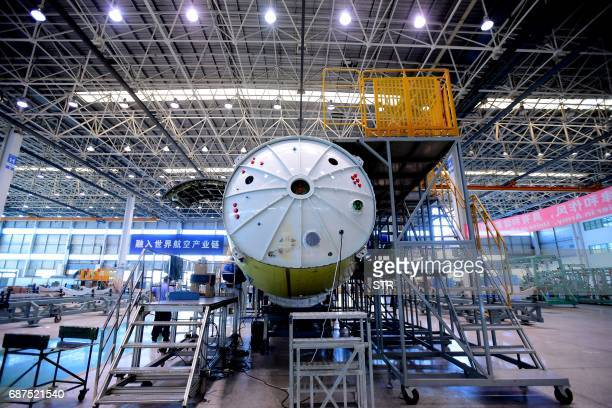 This photo taken on May 23 2017 shows Chinese workers assembling a Bombardier Q400 plane at a plant in Shenyang northeast China's Liaoning province /...