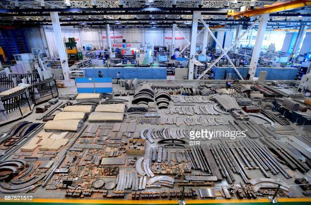 This photo taken on May 23 2017 shows Chinese workers assembling Bombardier Q400 planes at a plant in Shenyang northeast China's Liaoning province /...