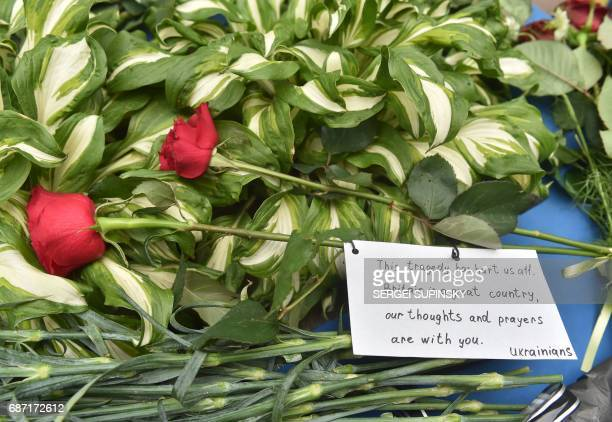 This photo taken on May 23 2017 shows flowers left in front of the British embassy in Kiev in tribute to victims of deadly Manchester Arena terror...