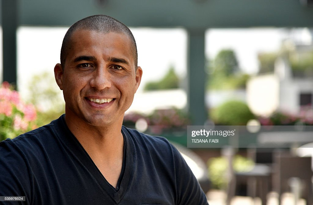 This photo taken on May 28, 2016 in Milan shows French former football player David Trezeguet posing during a interview with AFP. 'The goal is magnificent', Trezeguet declares as he recalls how he sealed France's final victory in the Euro 2000 championship with a golden goal against Italy in the Netherlands. The European Football Championship finals start in France on June 10. / AFP / TIZIANA