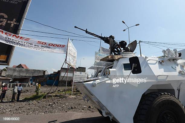 This photo taken on May 29 shows United Nations peacekeepers from Tanzania driving in an armoured vehicle through the streets of Goma Following a UN...