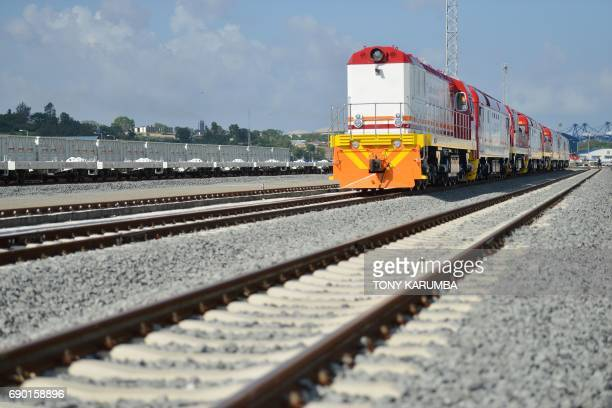 This photo taken on May 30 2017 shows diesel locomotive train cars at the container terminal of the port of the coastal town of Mombasa More than a...