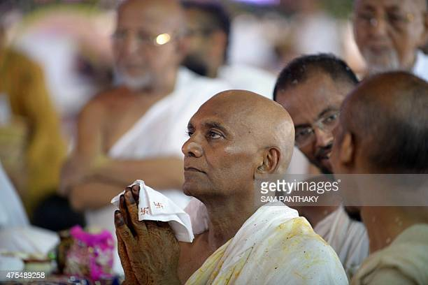 This photo taken on May 31 2015 shows millionaire Indian businessman Bhawarlal Doshi praying to a religious idol during a ceremony where he...