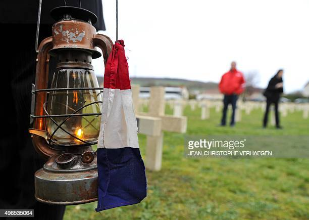 This photo taken on November 10 2015 in Verdun eastern France at the FaubourgPave cemetery shows an 'eternal flame' used for a dedication ceremony...