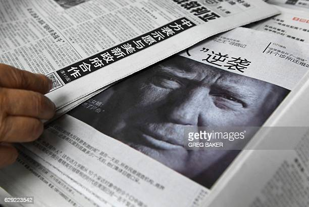 This photo taken on November 10 2016 shows a newspaper featuring a photo of US Presidentelect Donald Trump at a news stand in Beijing Chinese media...