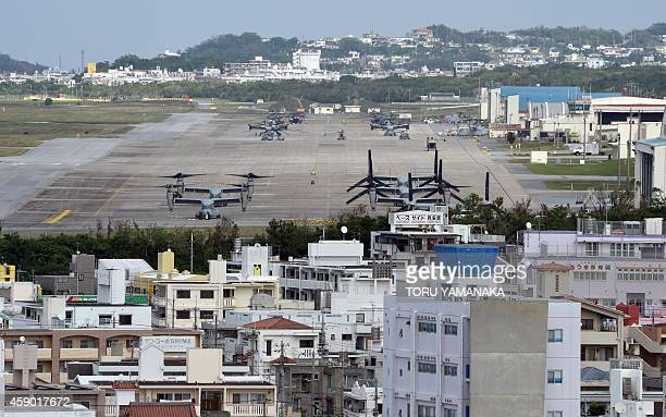 This photo taken on November 14 2014 shows multimission tiltrotor Osprey aircraft at the US Marine's Camp Futenma in a crowded urban area of Ginowan...