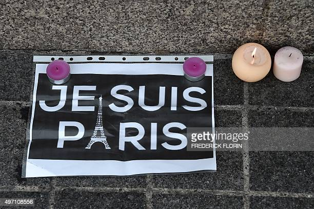 This photo taken on November 14 2015 in Strasbourg eastern France shows a memorial of flowers and candles following a series of terrorist attacks...