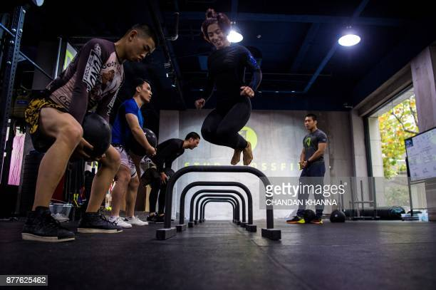 This photo taken on November 16 2017 shows MMA fighter Miao Jie jumping during a training session in Shanghai The 30yearold Shanghai native and...