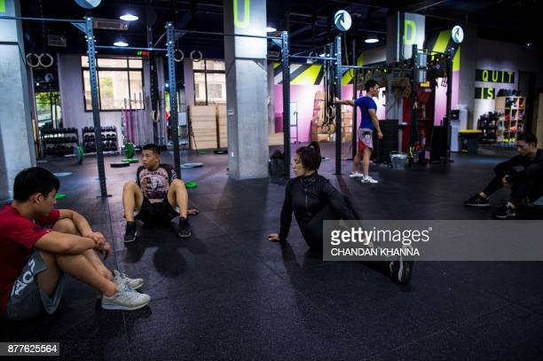 This photo taken on November 16 2017 shows MMA fighter Miao Jie stretching during a training session in Shanghai The 30yearold Shanghai native and...