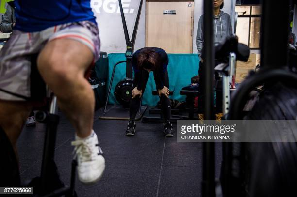 This photo taken on November 16 2017 shows MMA fighter Miao Jie during a training session in Shanghai The 30yearold Shanghai native and single mother...