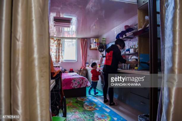 This photo taken on November 16 2017 shows MMA fighter Miao Jie cleaning dishes at her home in Shanghai The 30yearold Shanghai native and single...