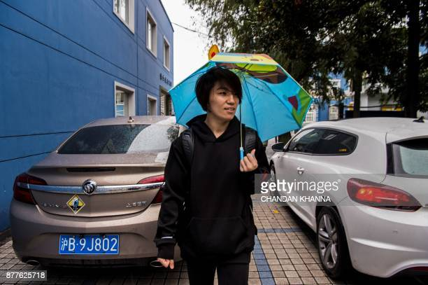 This photo taken on November 16 2017 shows MMA fighter Miao Jie walking back after dropping off her son at school in Shanghai The 30yearold Shanghai...