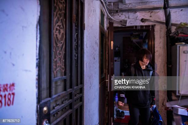 This photo taken on November 16 2017 shows MMA fighter Miao Jie leaving her home in Shanghai The 30yearold Shanghai native and single mother is now...