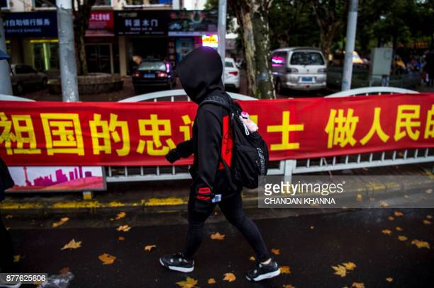 This photo taken on November 16 2017 shows MMA fighter Miao Jie walking to catch a bus to her training centre in Shanghai The 30yearold Shanghai...